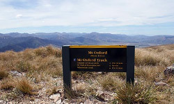 The sign at the summit of Mt Oxford